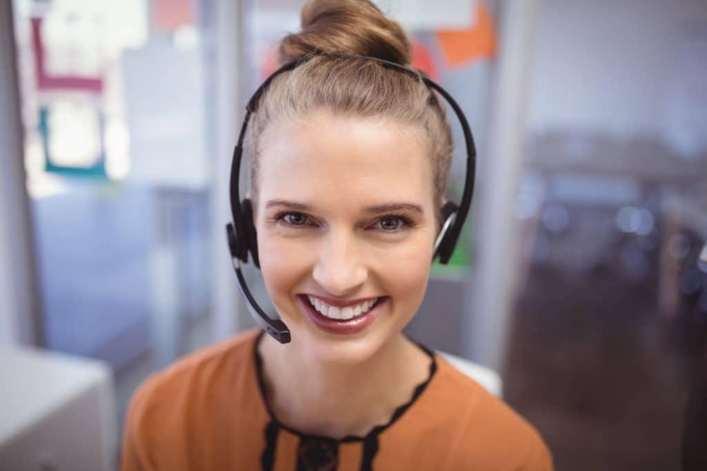 Portrait Of Smiling Customer Service Representativ Vrtxls7